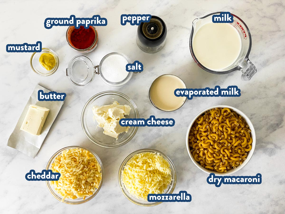 photo of ingredients to make crockpot Mac and cheese with text labels