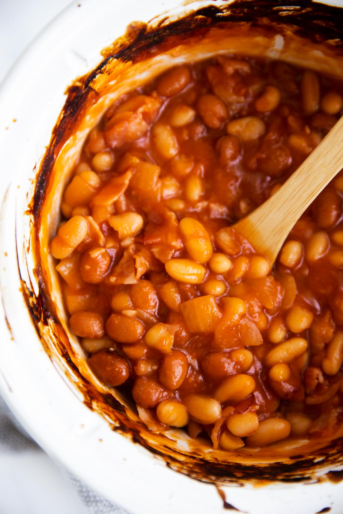 overhead view of baked beans in crockpot