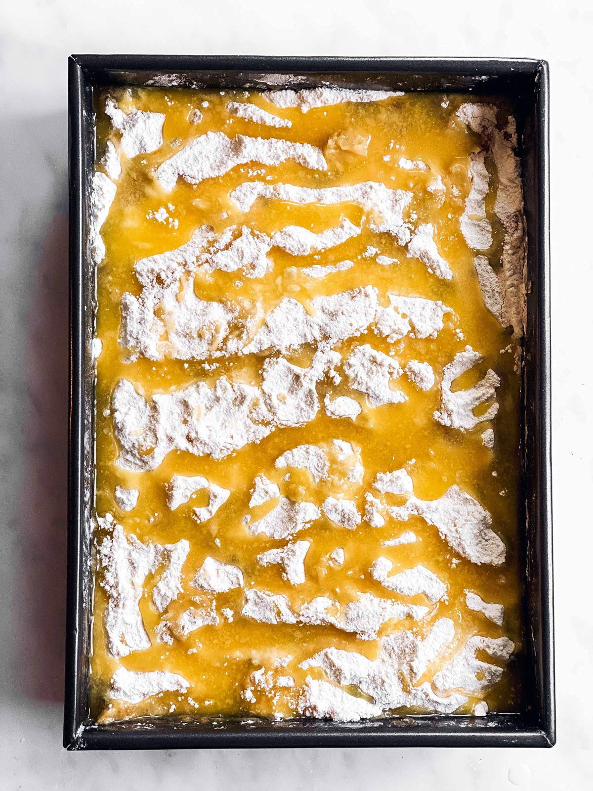 pan with apple pie filling, cake mix and melted butter
