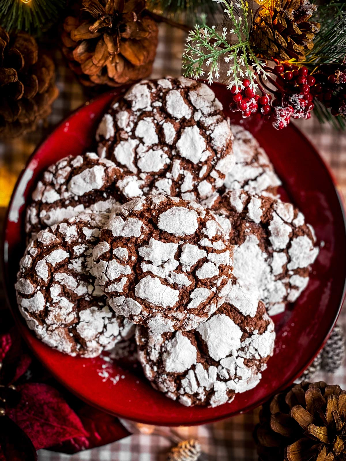 red plate with chocolate crinkle cookies