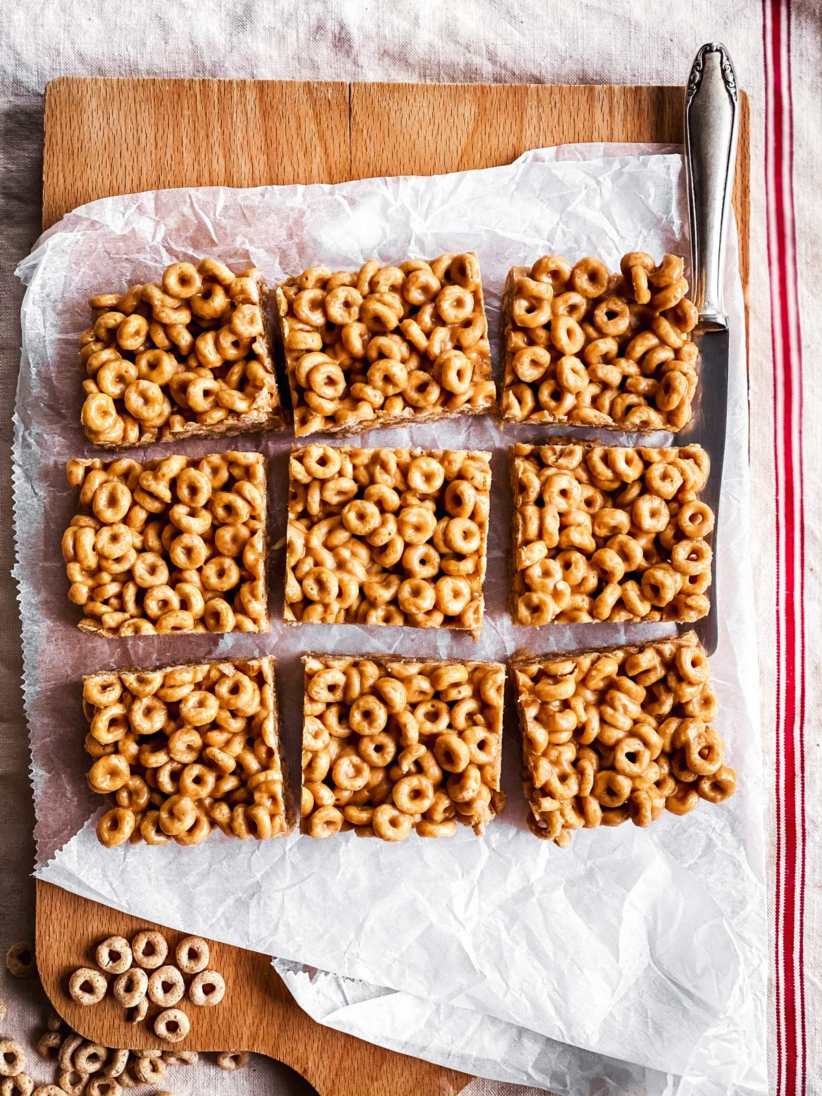 sliced peanut butter cheerio bars on wooden chopping board