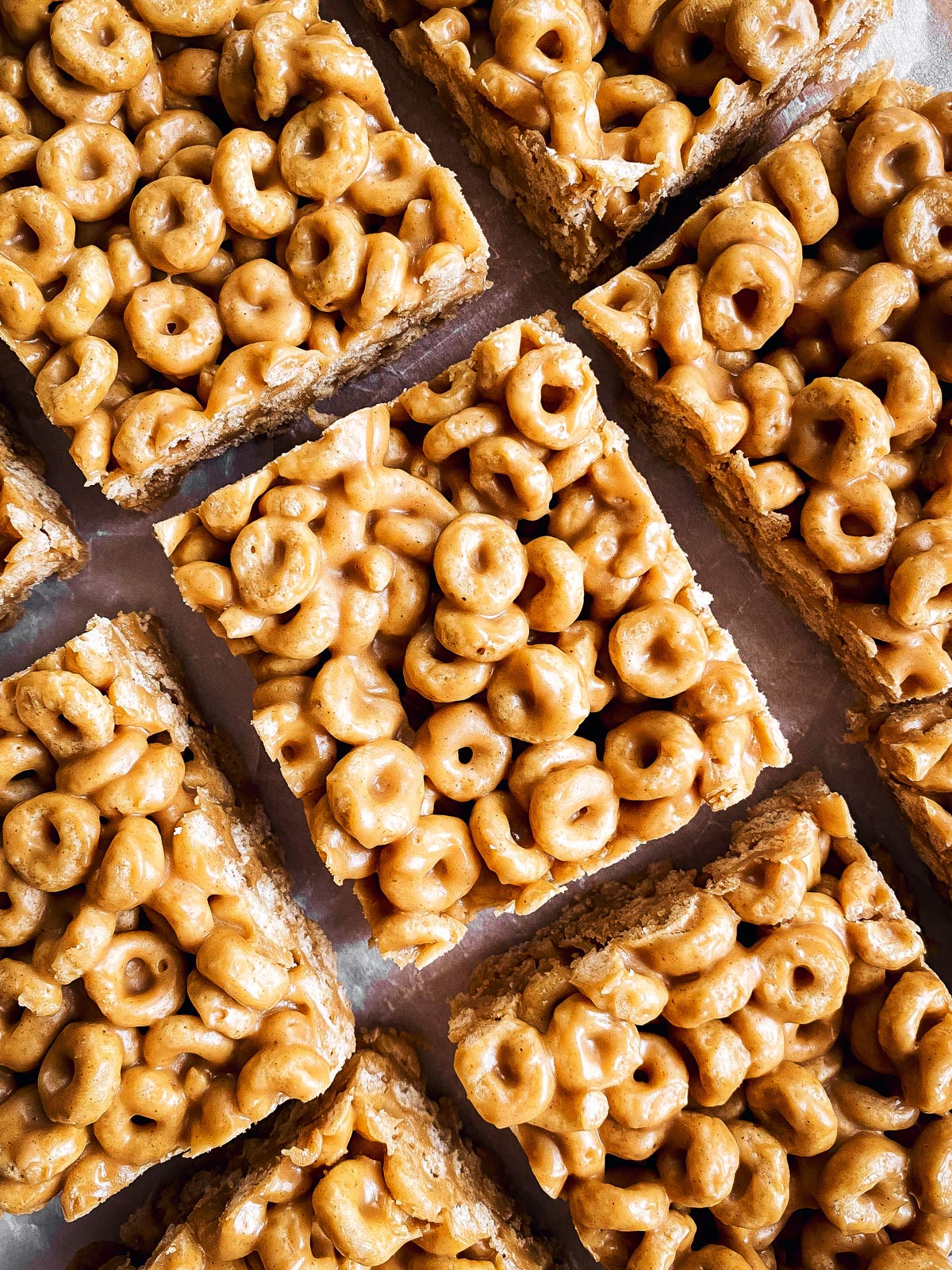 close up photo of sliced peanut butter cheerio bars