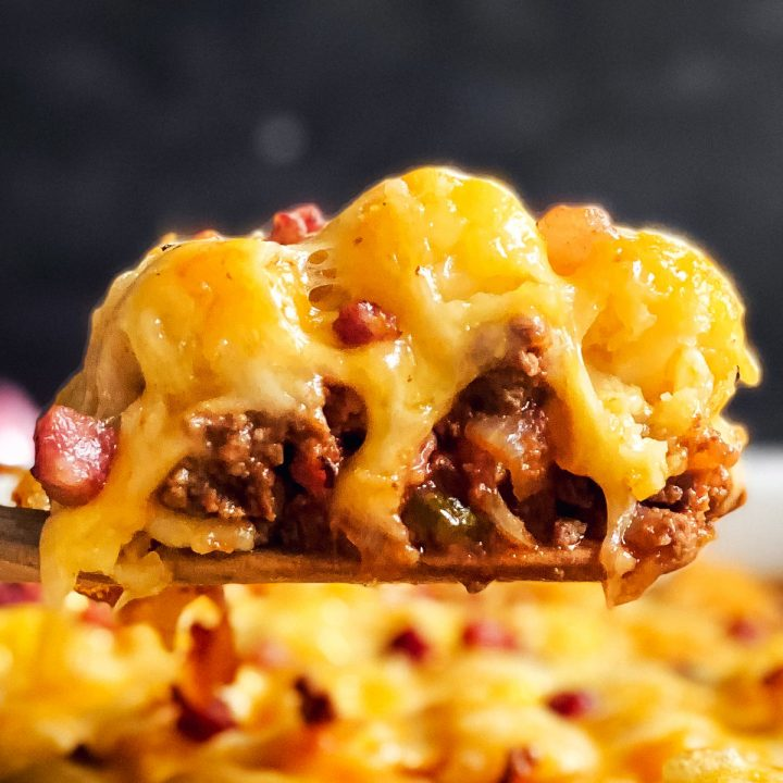 scoop of bacon cheeseburger tater tot c casserole on wooden spatula