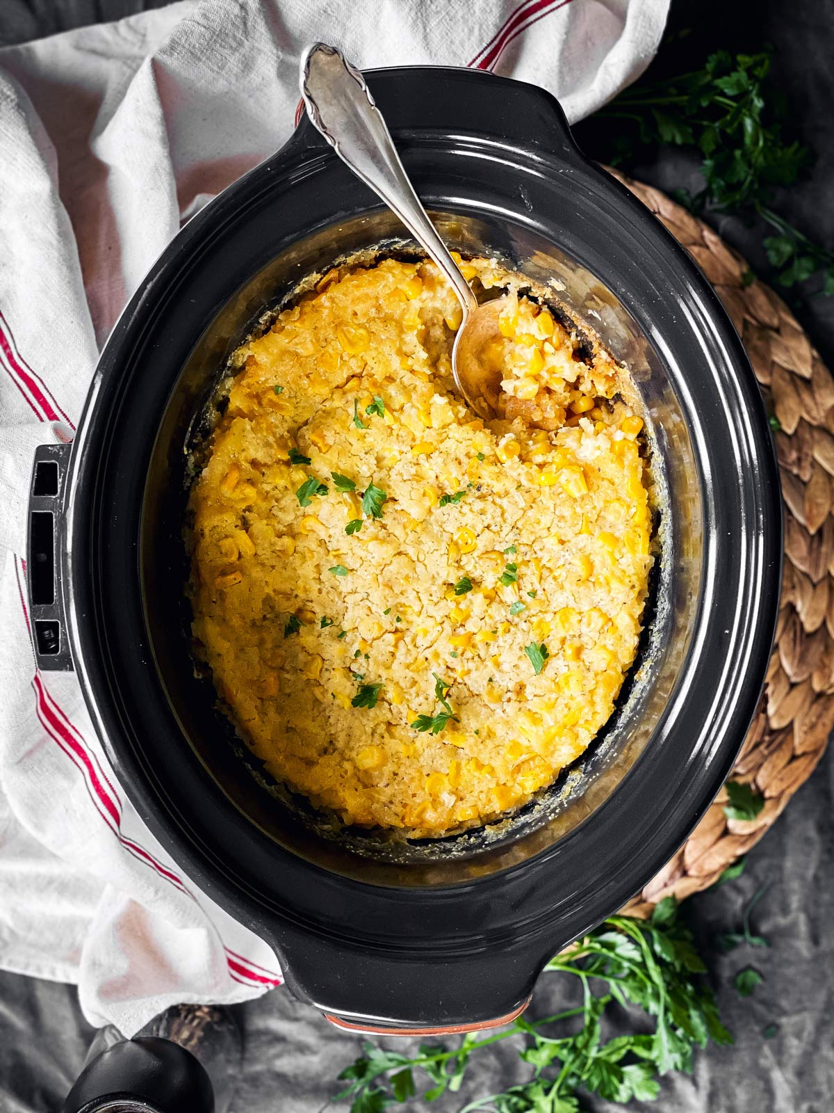 overhead view of slow cooker with corn casserole