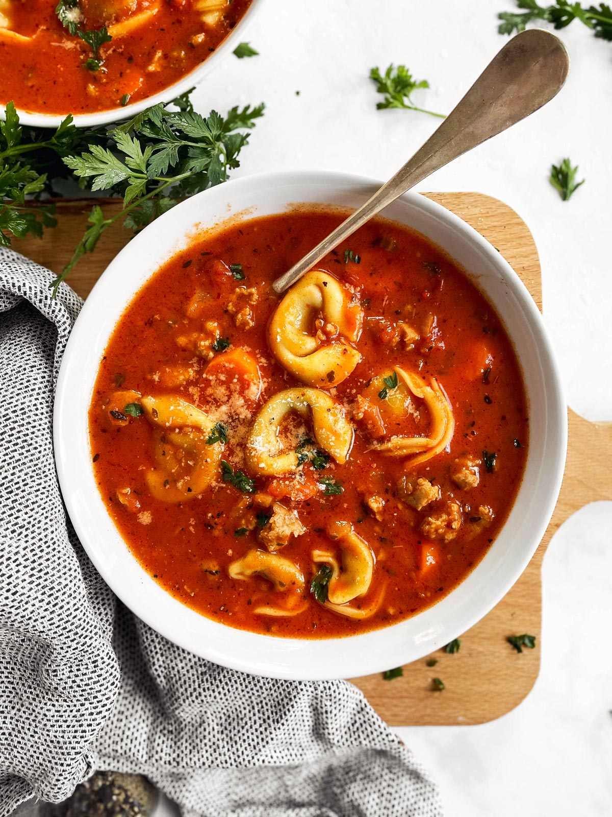 white soup plate with tortellini soup