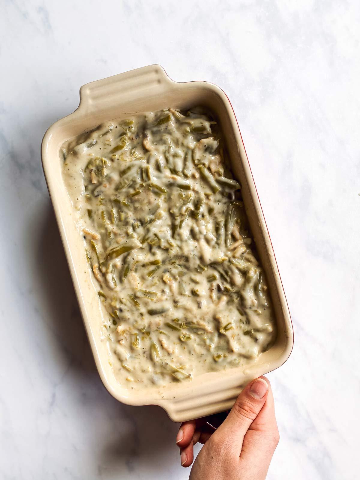 casserole dish with unbaked green bean casserole