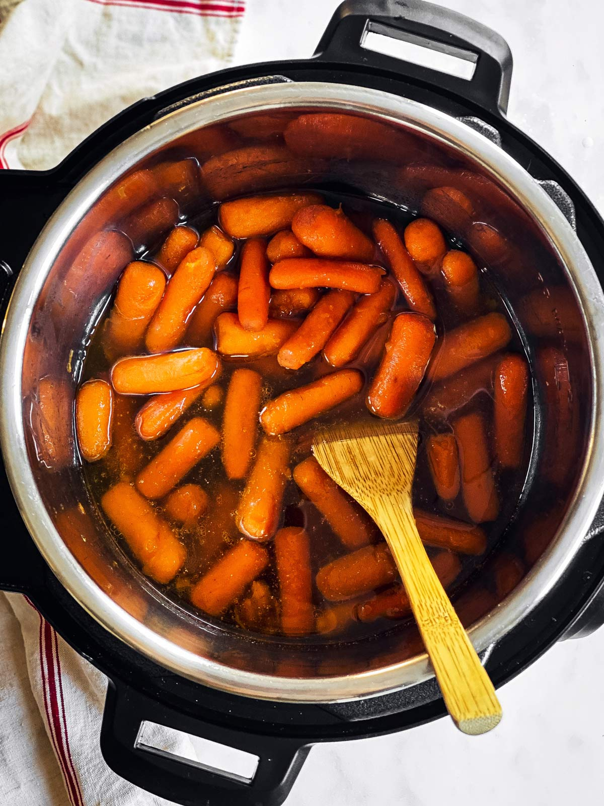 overhead view of instant pot with glazed carrots