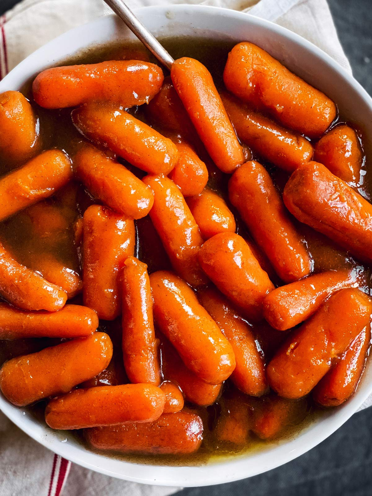 close up of bowl with glazed carrots