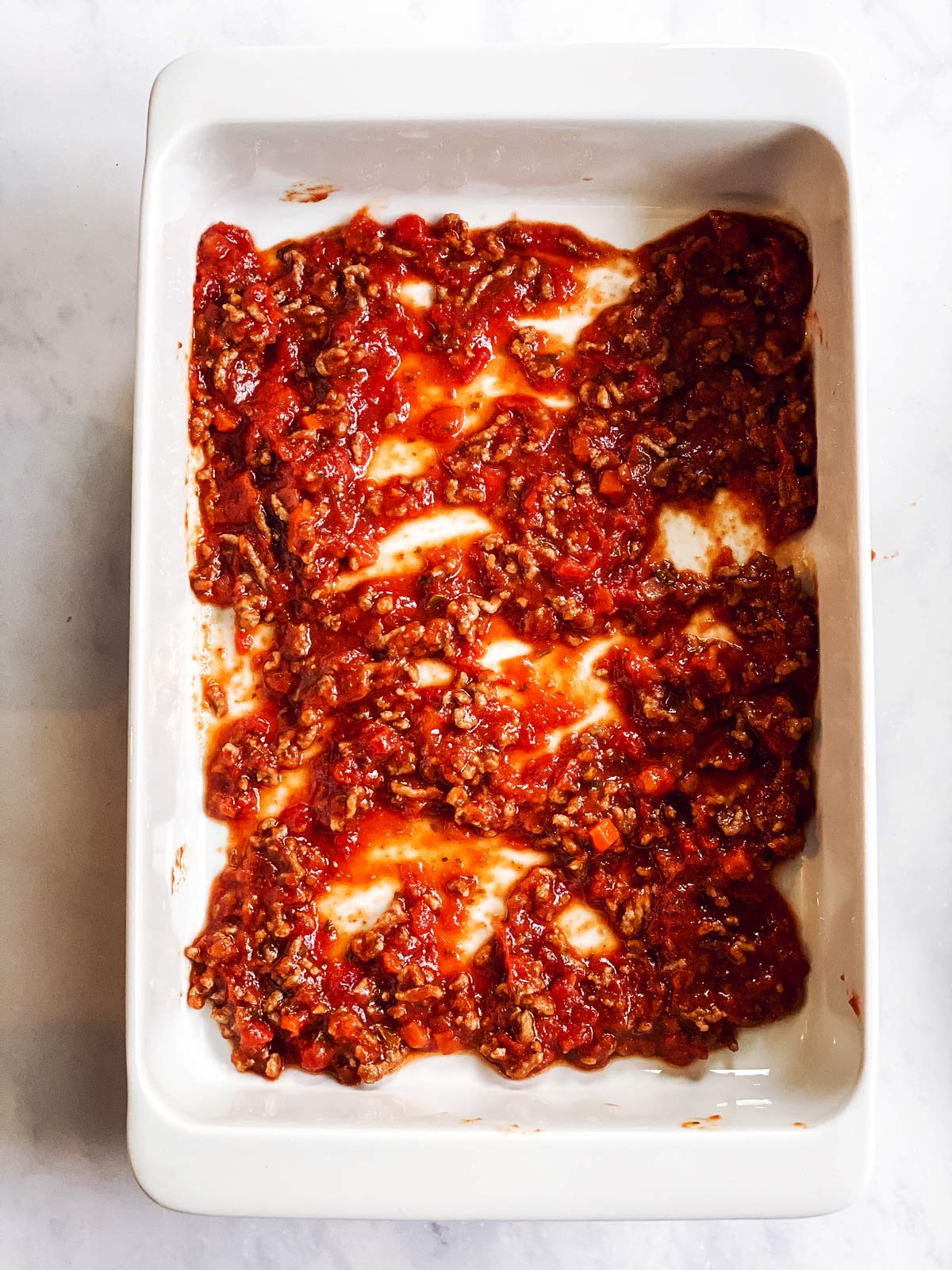 meat sauce in white casserole dish