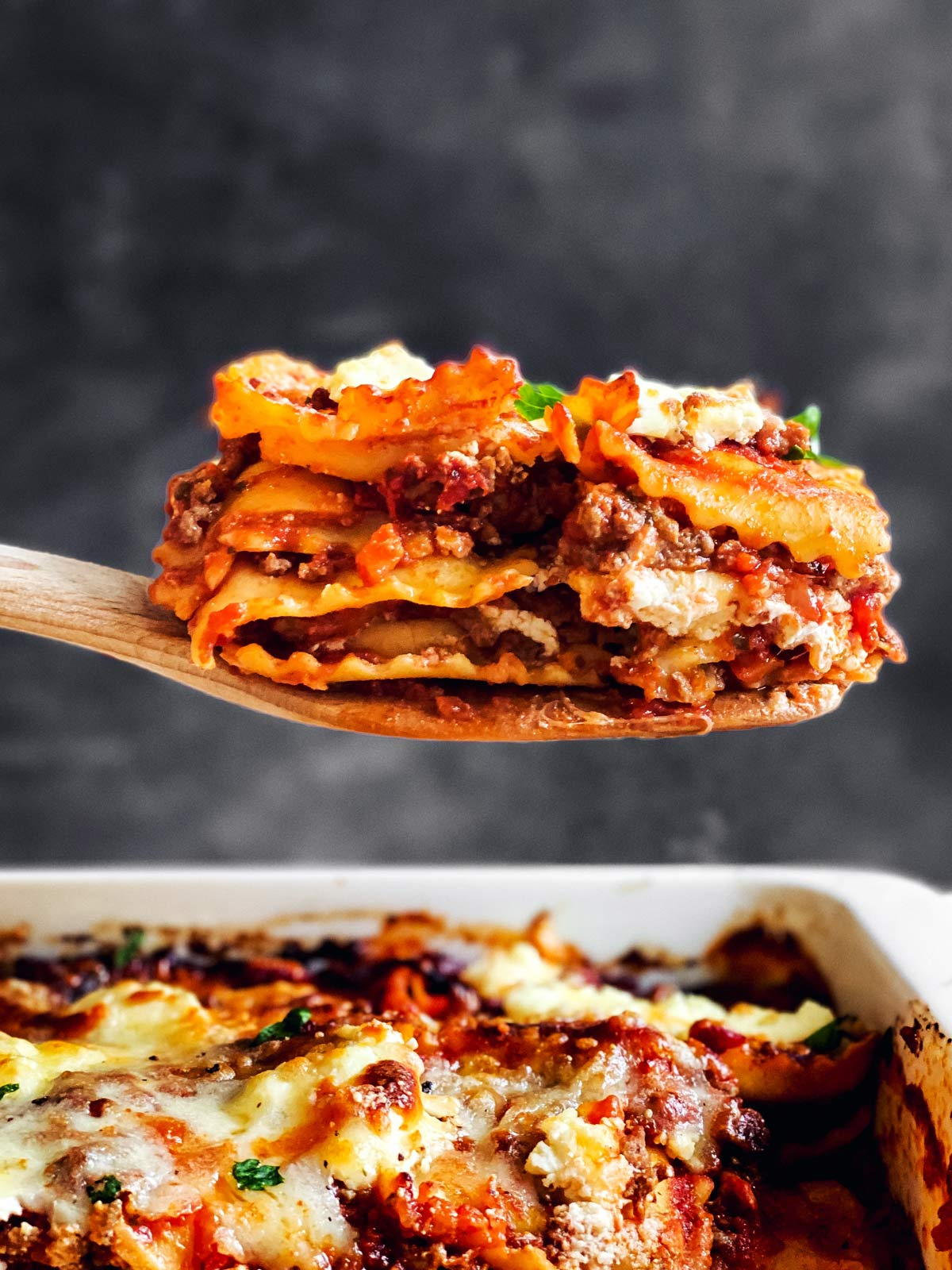 wooden spoon with slice of lazy lasagna