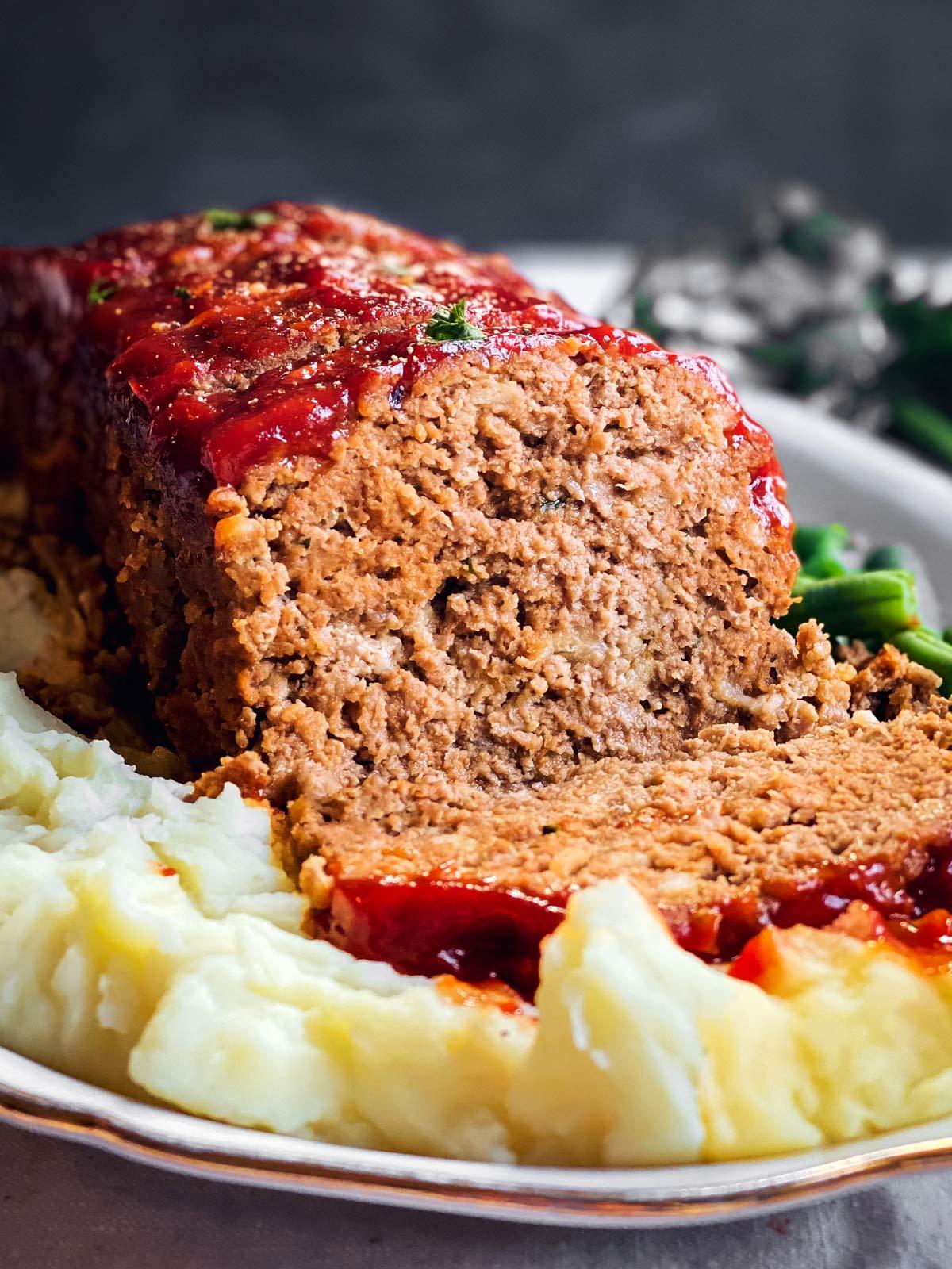 frontal view of sliced meatloaf on platter