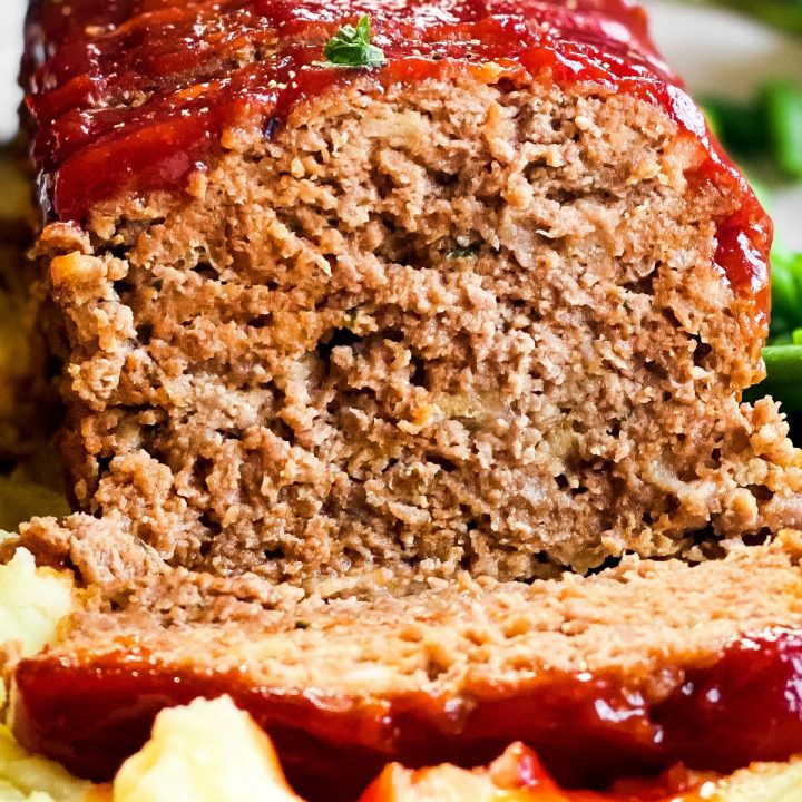 close up frontal view of sliced meatloaf