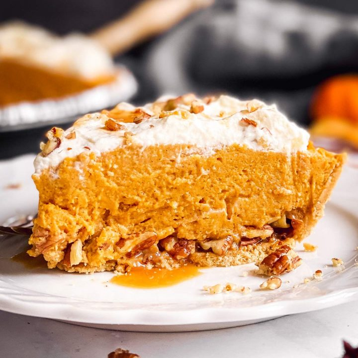 slice of turtle pumpkin pie on a white plate
