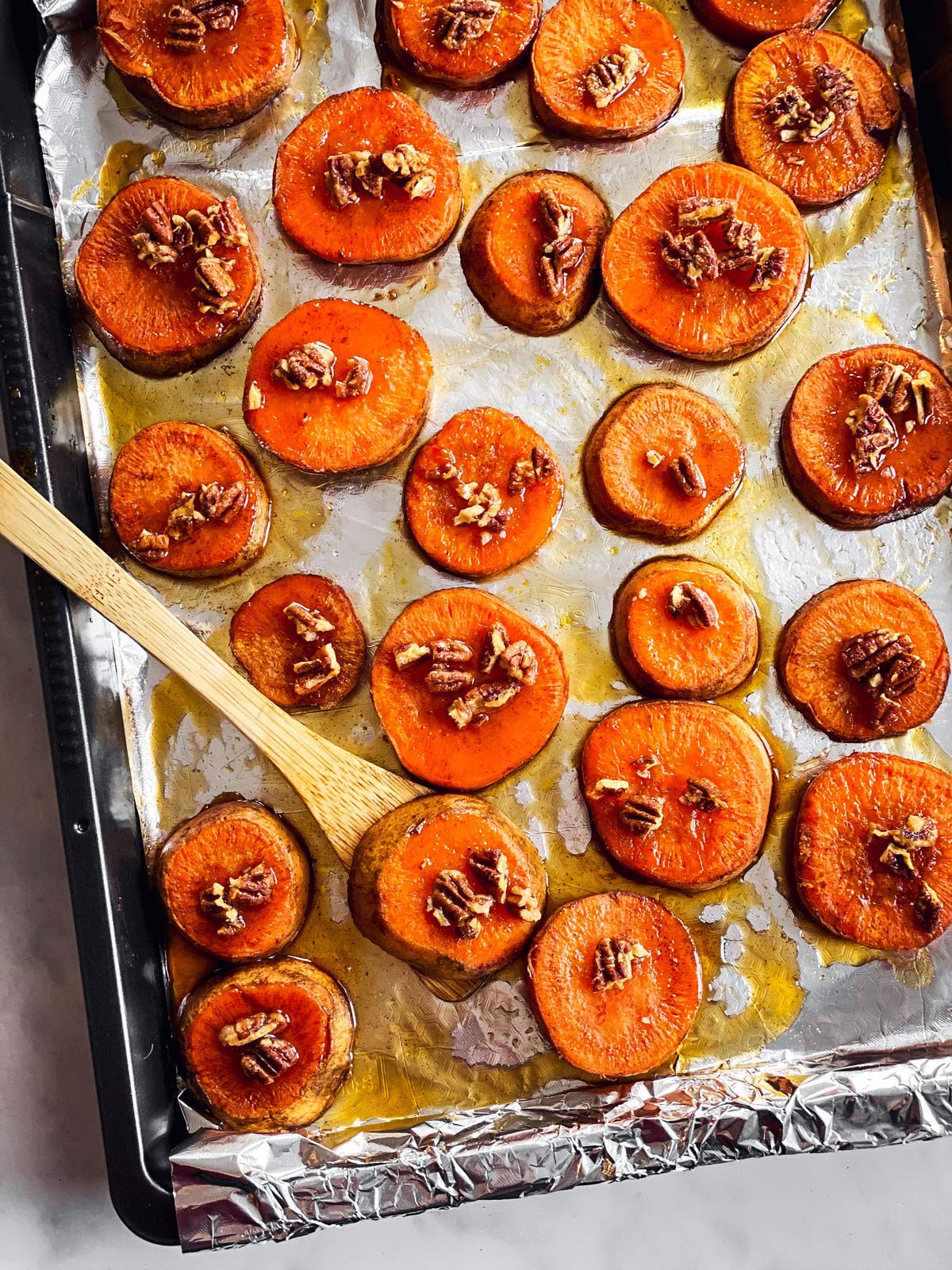 overhead view of baking sheet with baked sweet potato slices