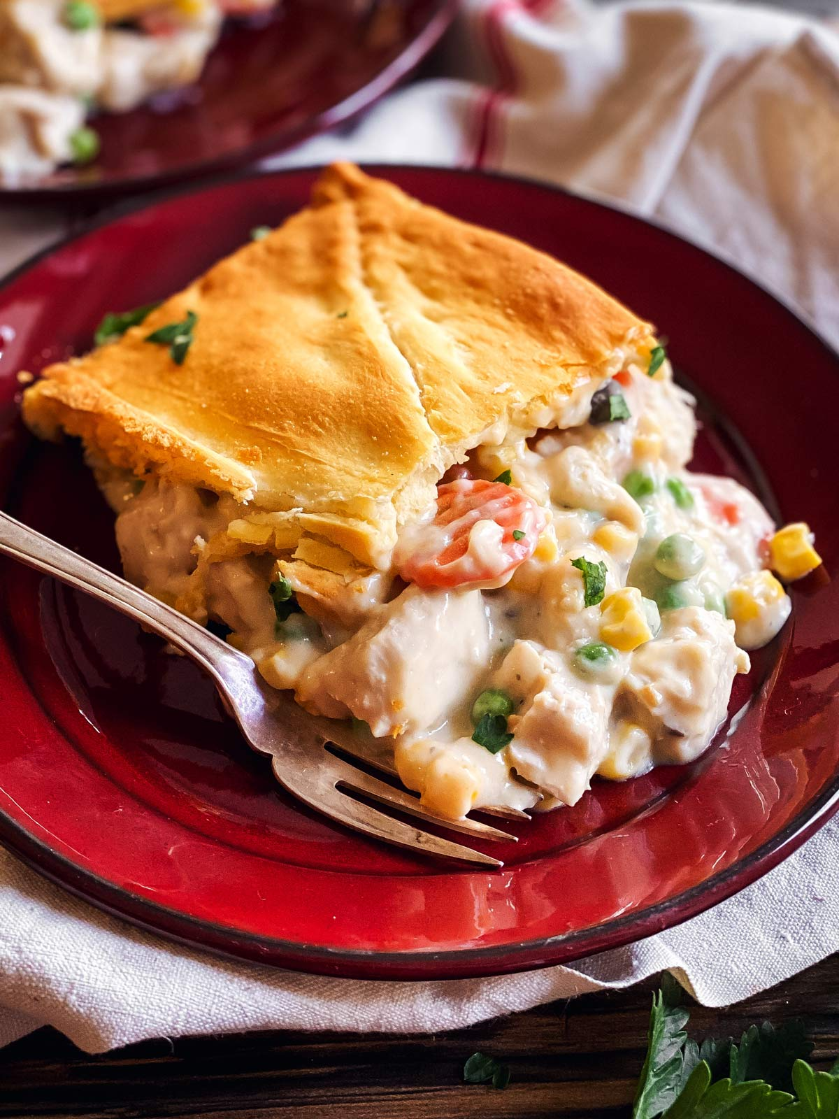 slice of leftover turkey pot pie on red plate